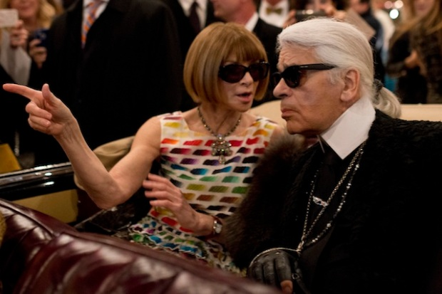 Anna Wintour with Karl Lagerfeld watching the show inside a vintage car