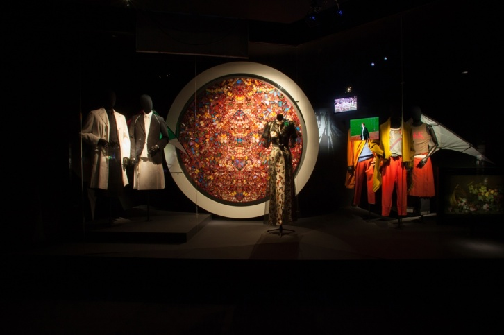 Elsa Schiaparelli's ensemble and Damien Hirst painting.
