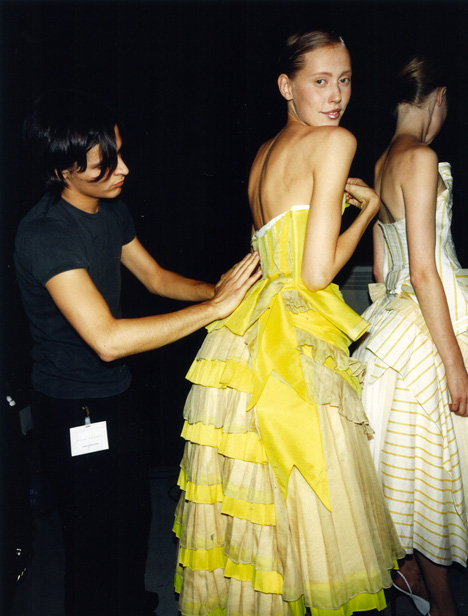Oliver Theyskens as a young designer. Backstage photograph by Gauthier Gallet, 2001