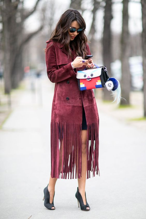 She rocks this fringe coat ! you can find fringe anywhere, so just add this detail to your look © Pinterest